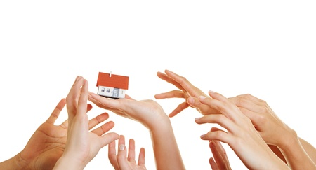 reaching: Many hands reaching for a small house home