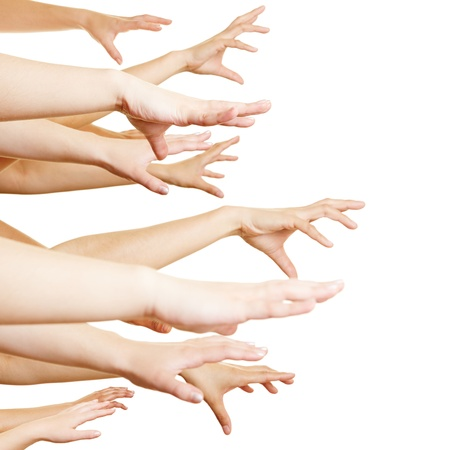 grasp: Many desperate hands reaching sideways into the air Stock Photo