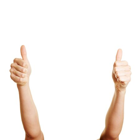 two thumbs up: Woman holding two thumbs up into the air Stock Photo