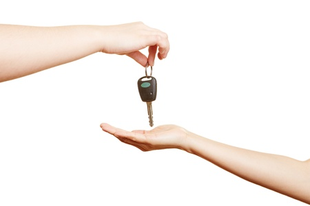 car keys: Car dealer offering car keys to a hand