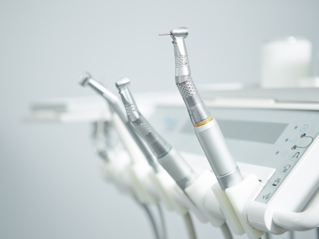 Different dental instruments and tools in a dentists office photo