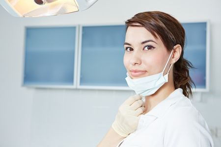 dental assistant: Smiling dental assistant with mouthguard in dental practice