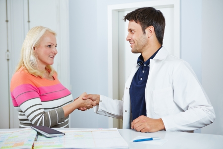 farewell: Doctor and senior patient shaking hands to say goodbye