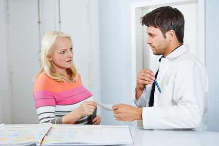 prescribe: Doctor giving senior woman a prescription into her hand Stock Photo