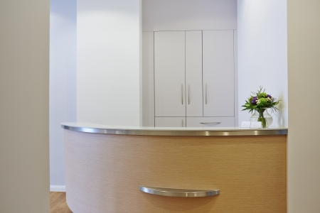 office interior design: Bright empty reception at a doctors office