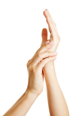 Two female hands using moisturizer for skin care photo