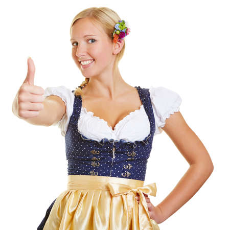 dirndl: Smiling happy woman in a dirndl holding her thumbs up Stock Photo