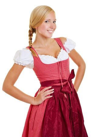 arms akimbo: Young attractive bavarian woman in a dirndl with arms akimbo
