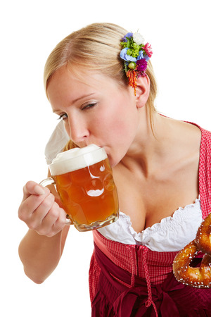 wiesn: Young bavarian woman in a dirndl drinking beer