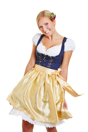 dirndl: Young bavarian happy woman dancing in a dirndl Stock Photo