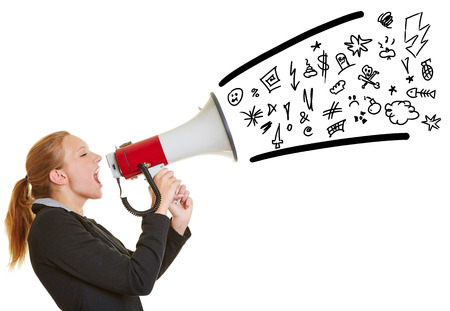 speaking tube: Young angry business woman ranting in a megaphone with symbols coming out Stock Photo