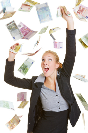 Happy young business woman catching many euro money bills photo