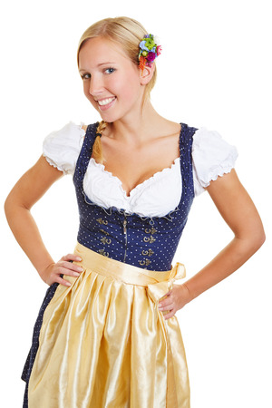 Happy young bavarian woman smiling in a dirndl photo