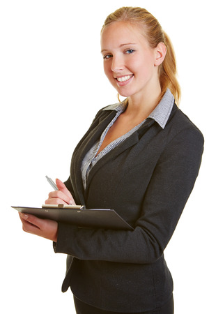 taking inventory: Young smiling business woman with pen and a clipboard