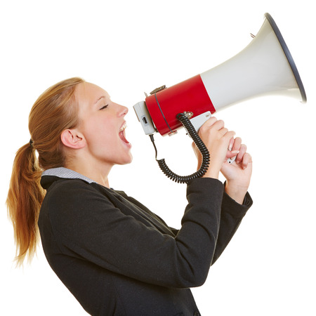 woman screaming: Angry frustrated business woman screaming in a megaphone