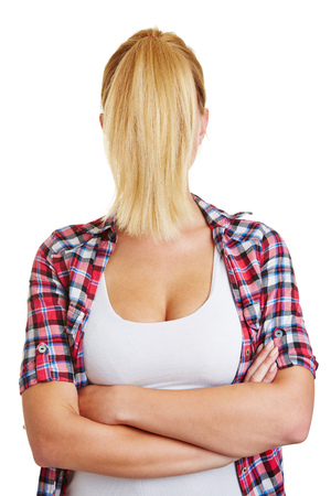 Blond young woman with a ponytail in front of her face photo