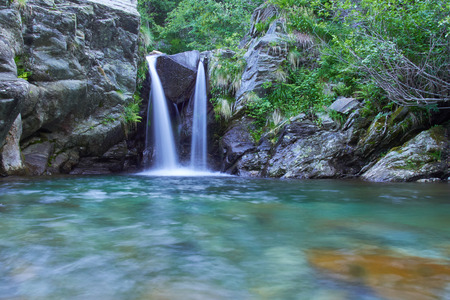 vale: Small waterfall with a brook in the Italian Alps in the Vale Grande