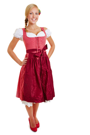 dirndl: Blond happy bavarian woman smiling in a dirndl