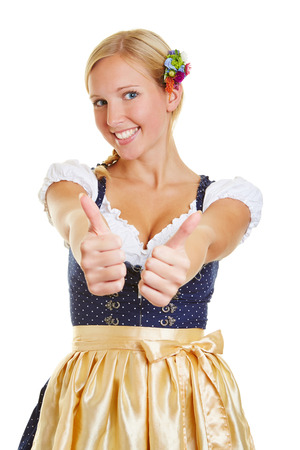dirndl: Happy bavarian woman in a dirndl holding both two thumbs up