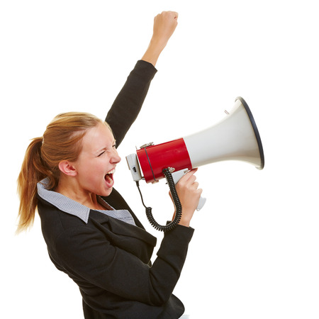 speaking tube: Angry business woman protesting with megaphone and clenched fist Stock Photo
