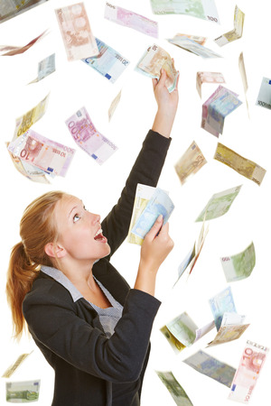 flying woman: Happy lucky business woman catching flying Euro money banknotes