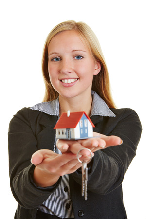renter: Young business woman with house and keys on her hands Stock Photo