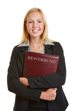 Young business woman with application portfolio at job interview photo