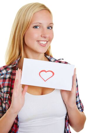 Young blond woman holding a love letter with red heart photo