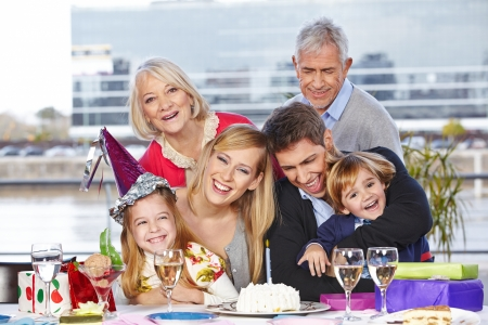 childrens birthday party: Happy family having fun at birthday party of their daughter Stock Photo