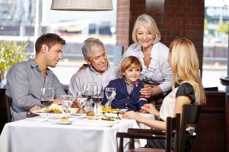 out to lunch: Happy family sitting in a restaurant and eating out