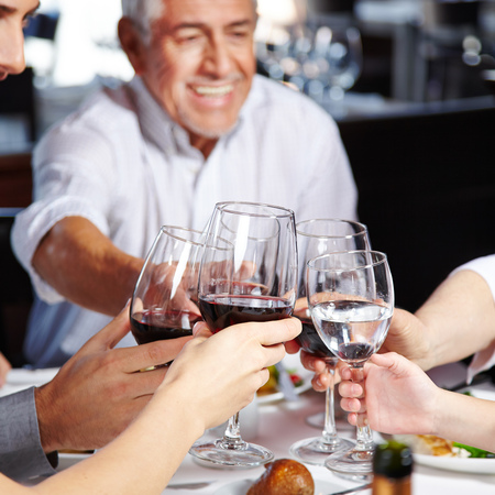 Big happy family eating and drinking together at the table Stock Photo