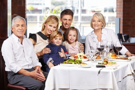 Portrait of a happy family with children and grandparents at the dining table Stock Photo - 23051893