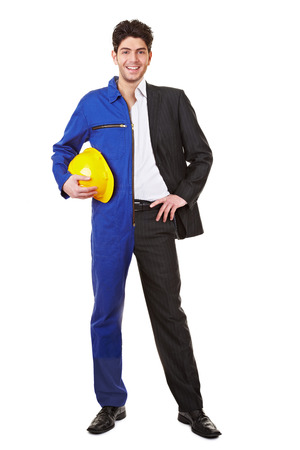 jump suit: Young man standing half in a jump suit and business clothing Stock Photo