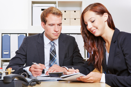 tax consultants: Cooperation between two business people in the office
