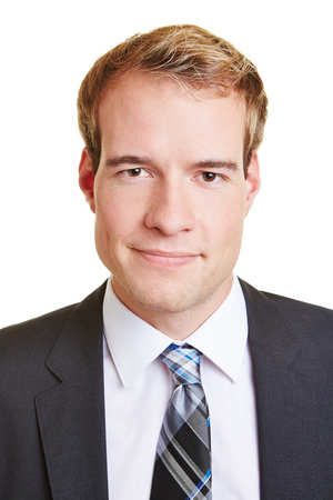 Head shot of young smiling business man in a suit photo