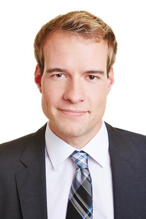 foto carnet: Jefe foto de hombre joven sonriente en un traje Foto de archivo