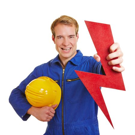 Happy electrician holding a red flash as energy symbol photo