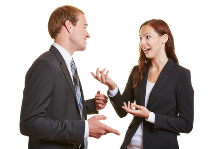 Two business people talking engaged to each other and using their hands Stock Photo