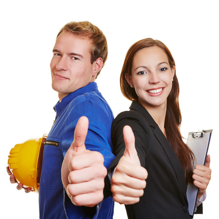 consent: Worker and business woman holding thumbs up together and smiling