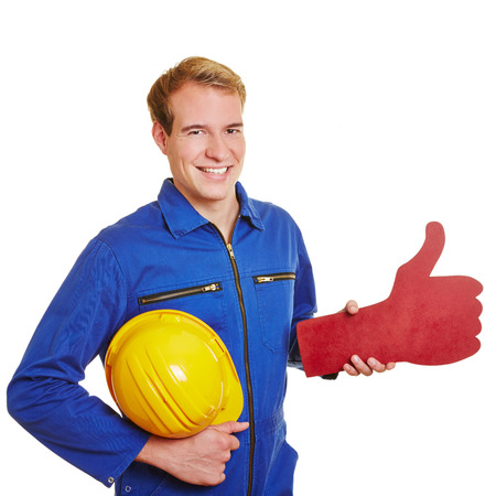 Happy construction worker holding an oversized red thumb up photo