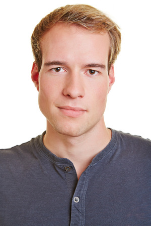 Neutral frontal head shot of a young attractive man