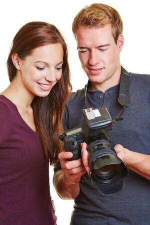microstock: Photographer showing his model images on the camera display