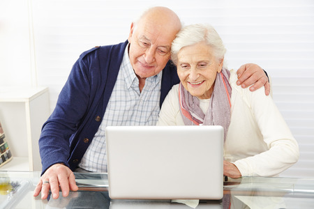 old pc: Senior couple using ecommerce in internet with laptop computer Stock Photo