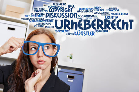 overachiever: Business woman in the office thinking in German language about copyright law