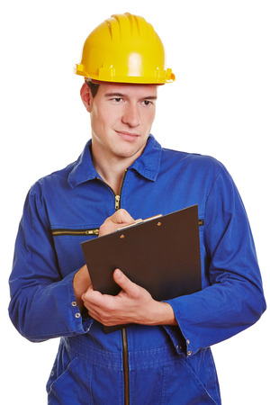 examiner: Examiner with clipboard and helmet checking a construction site