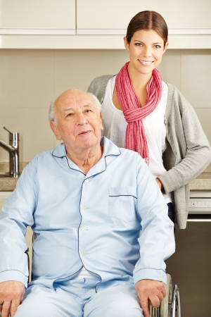 Extended home care for senior man in wheelchair photo
