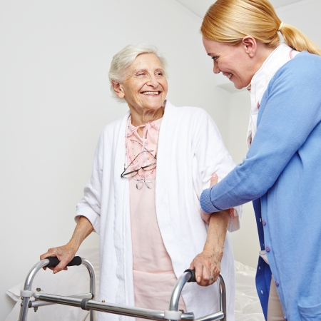 nursing staff: Geriatric nurse helping senior citizen woman with walker