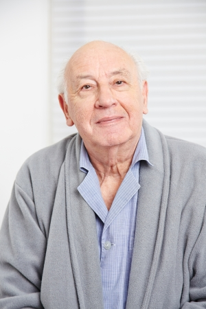 demented: Face of an smiling old man in a retirement home Stock Photo