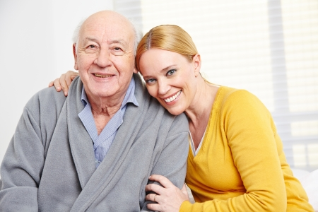 nursing staff: Happy family with woman embracing senior citizen man Stock Photo