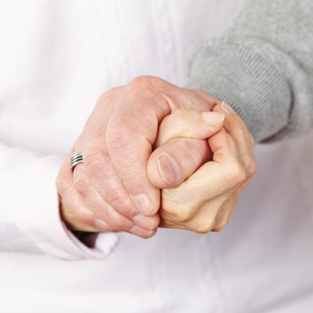 condolence: Happy senior citizen couple holding their hands together Stock Photo